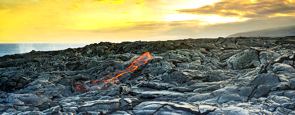 Fresh lava breaking through at the Kalapana lava flows, on the big island of Hawaii.