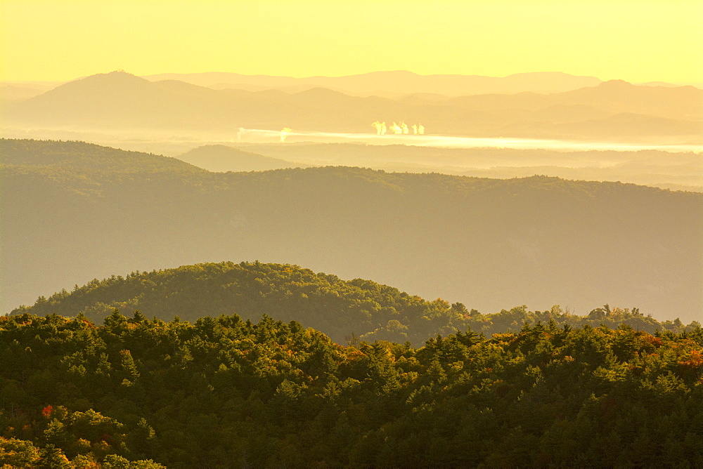 Smokestacks and pollution in the populated valley behind the Linville Gorge Wilderness, Pisgah National Forest, Linville, North Carolina.