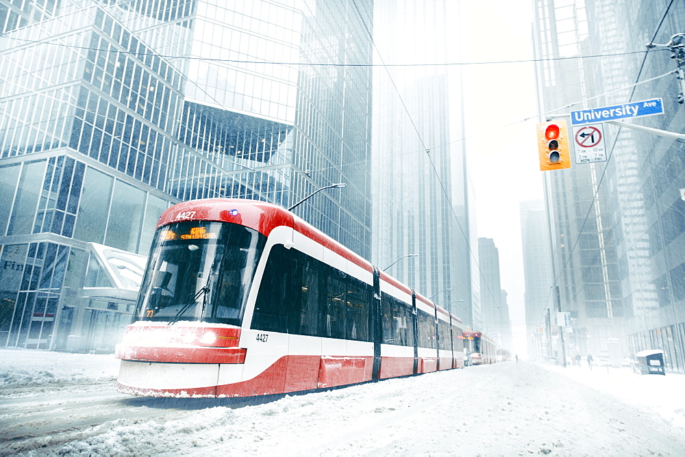 Composition of several street cars on a snowy winter day in Toronto.