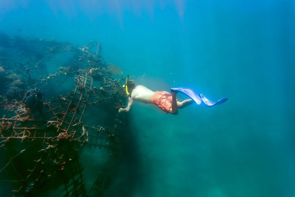 Side view of man snorkeling underwater in Indian Ocean, Permuteran, Bali, Indonesia