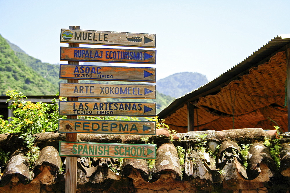 Directional sign pointing to various points of interest in a remote town in Guatemala