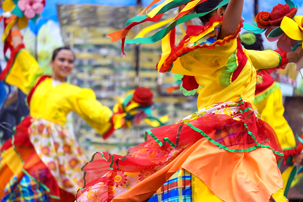 Women in colorful costumes performing at Dinagyang Festival, Iloilo, Philippines