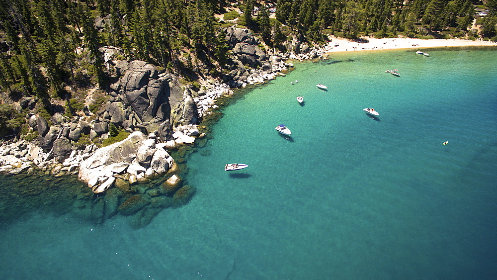Photograph with aerial view of boats near shore of Lake Tahoe, California, USA