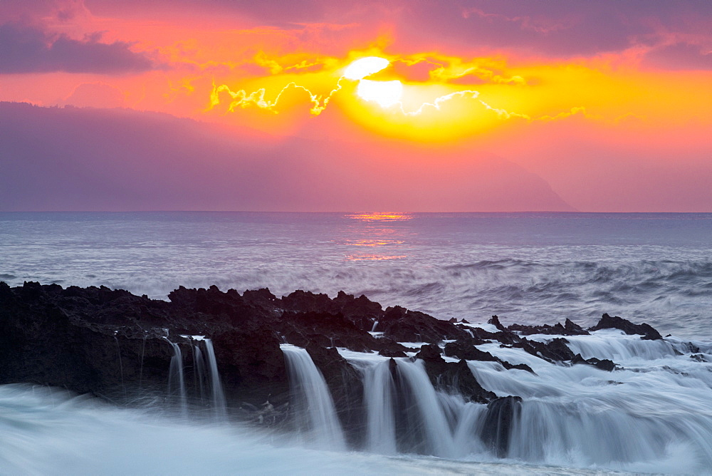 Crashing waves during sunset and a high swell episode at Shark's Cove, on the North shore of Oahu, Hawaii.