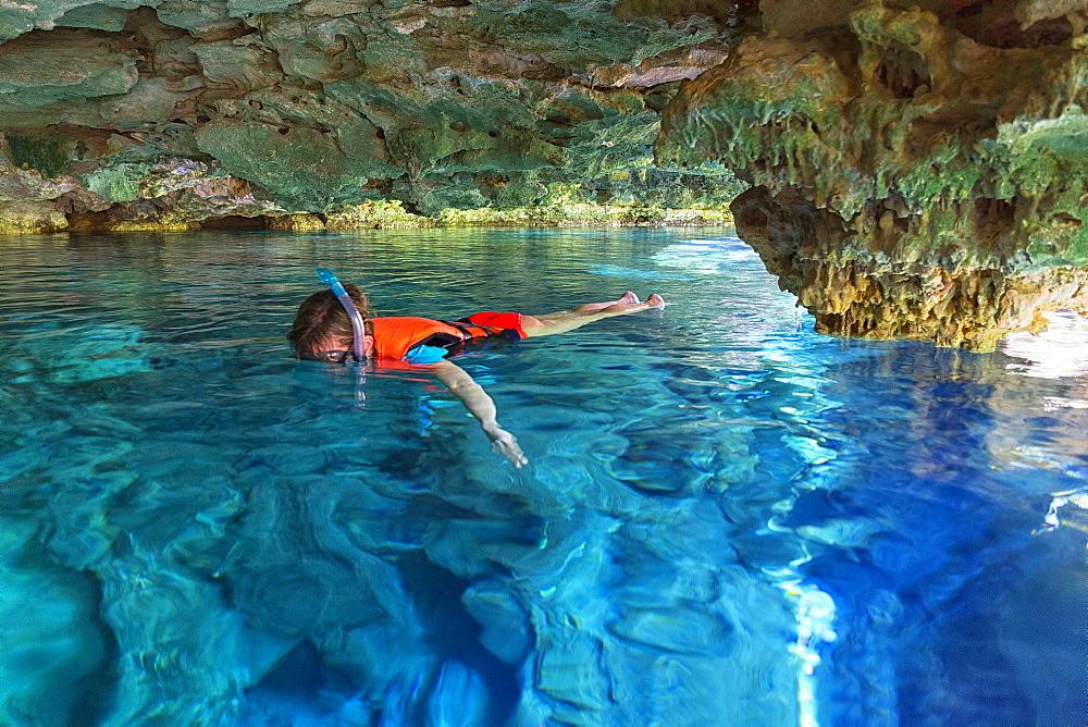 Photograph of man snorkeling in Cenote Chikin Ha, Playa del Carmen, Mayan Riviera, Yucatan Peninsula, Mexico