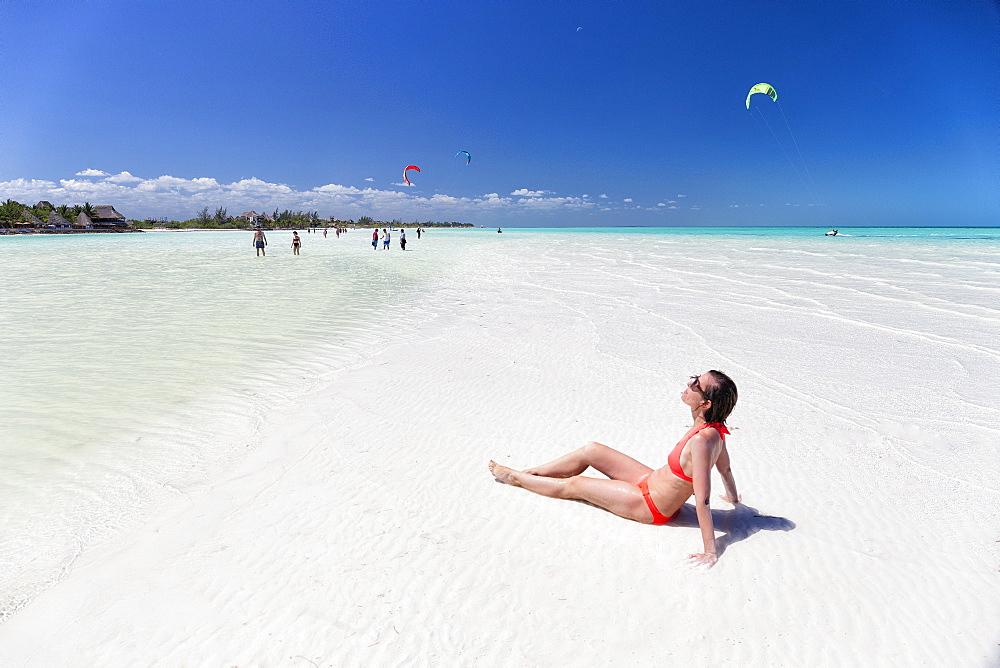 Tourists sunbathing on idyllic beach in Holbox, Holbox Island, Cancun, Yucatan, Mexico