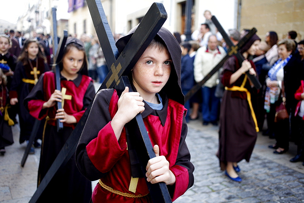 Boys and girls carrying crosses during Easter Week celebrations in Baeza, Jaen Province, Andalusia, Spain