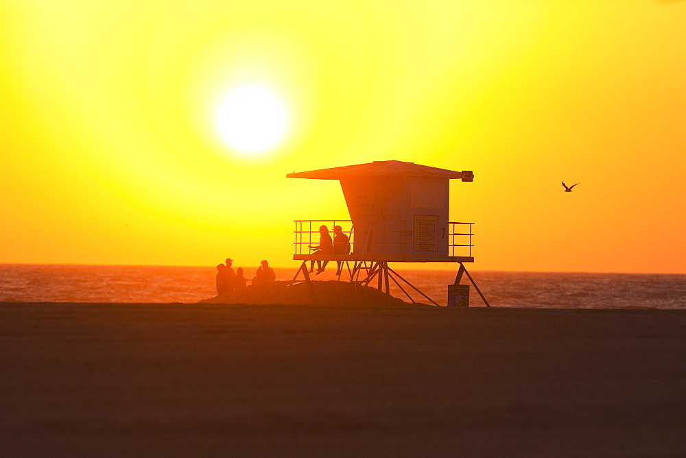 Silhouette of lifeguard tower at Huntington Beach, Orange County, California, USA