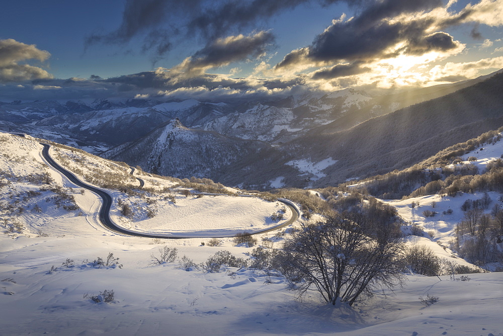 Scenic view of winter scenery with road and mountains, San Glorio, Liebana, Cantabria, Spain