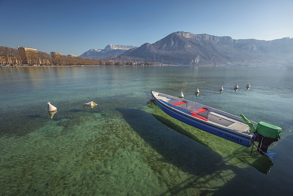 Tranquil scene with motorboat in lake, Annecy, Haute-Savoie, France