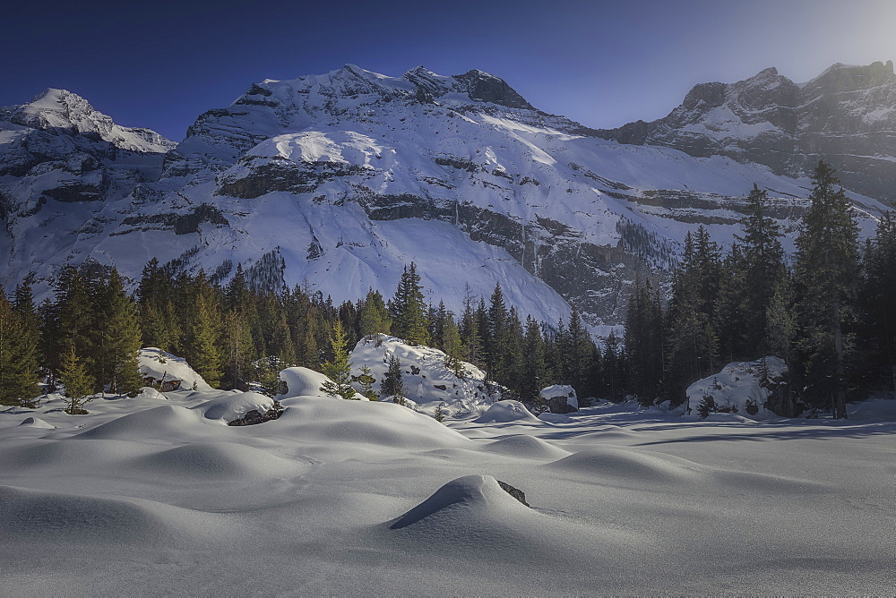 Majestic natural scenery with snow covered mountains in winter, Switzerland