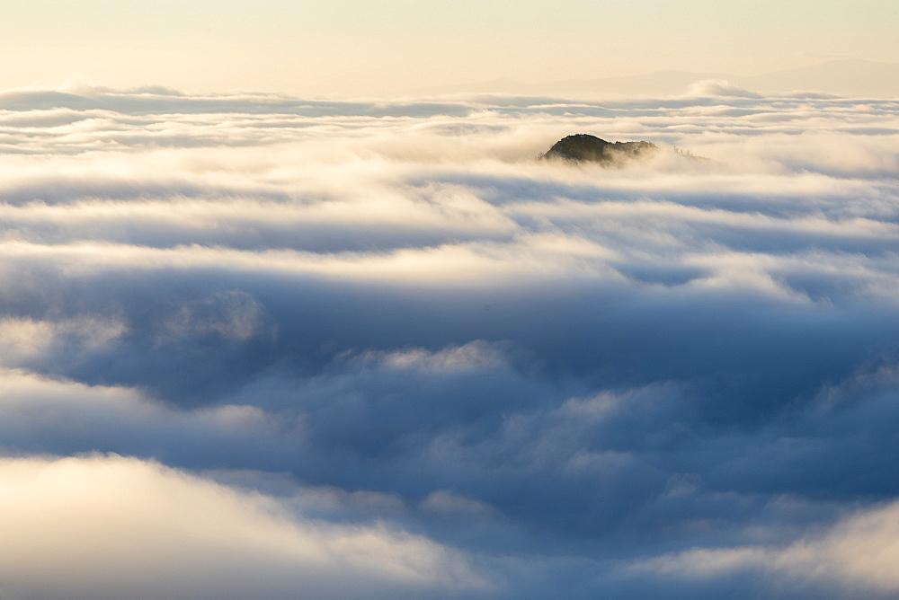 Scenic view of mountain peak among clouds, Cheile Rametului, Alba County, Romania