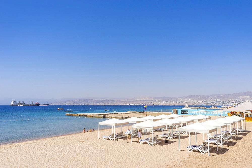 View of beach with cabanas of Gulf of Aqaba, Aqaba, Jordan