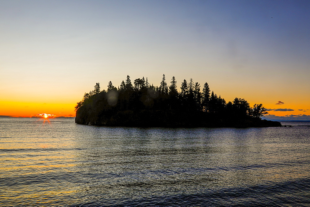 Beautiful scenery with silhouette of island with trees at sunset, Two Harbors, Minnesota, USA