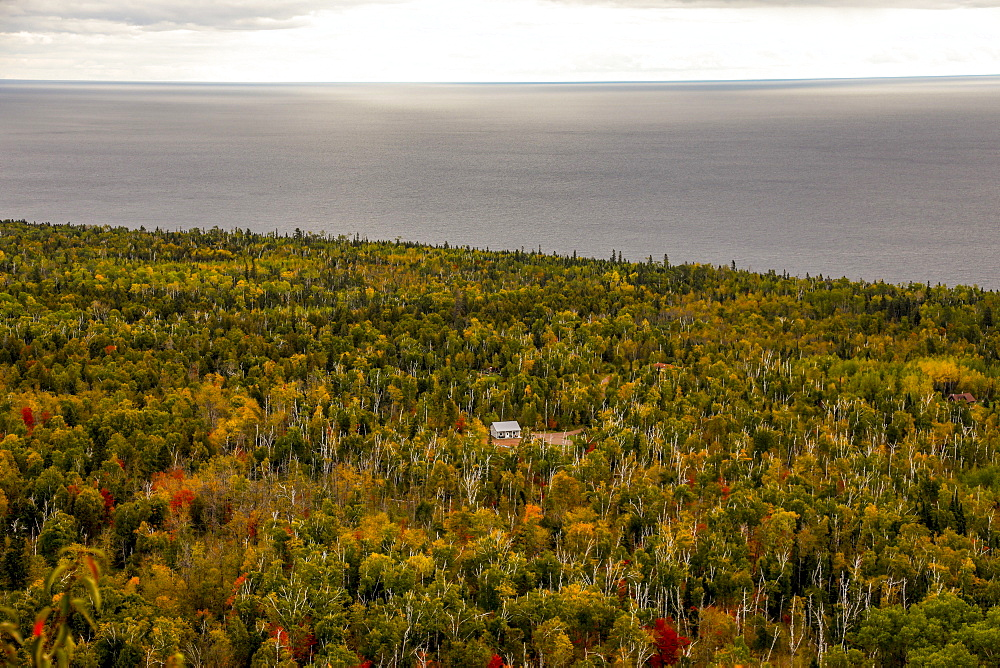 Scenic view of forest with log cabin and sea, Oberg Mountain hiking trail, Tofte, Minnesota, USA