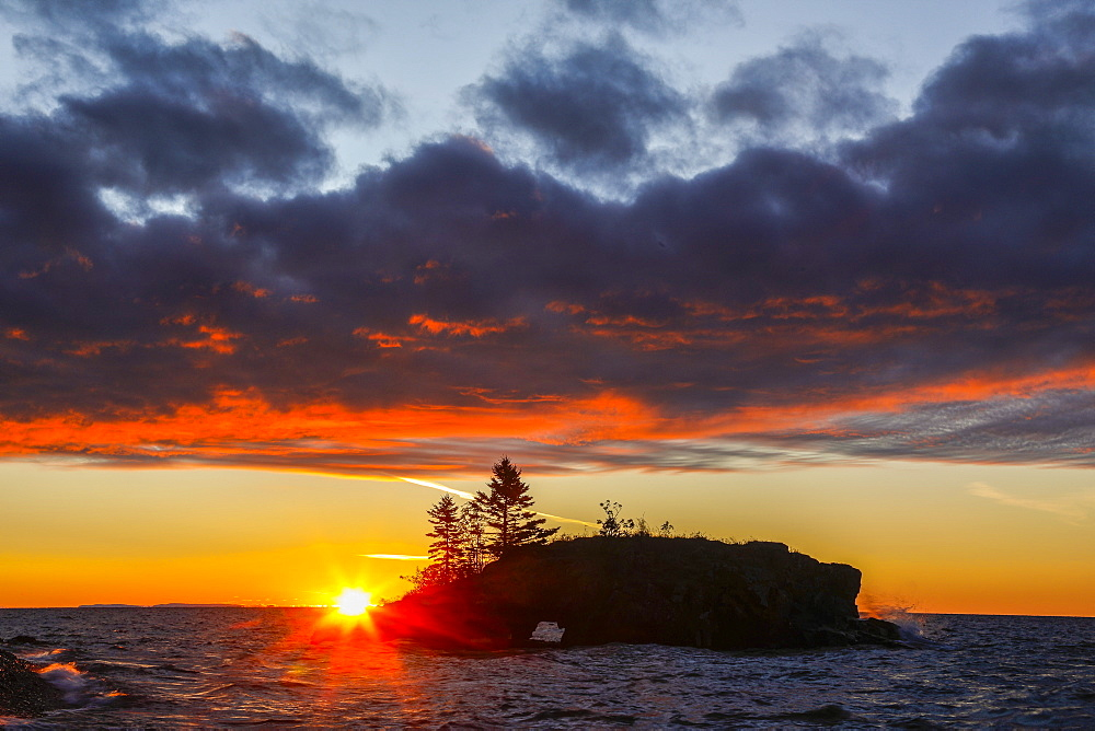 View of rock formation called Hollow Rock at sunset, Lake Superior, Grand Portage, Minnesota, USA