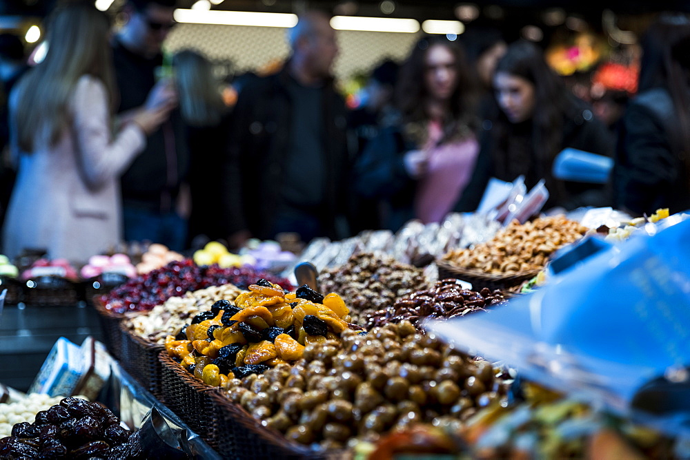 View of dried fruits and nuts on market stall at La Boqueria Market in Barcelona, Spain