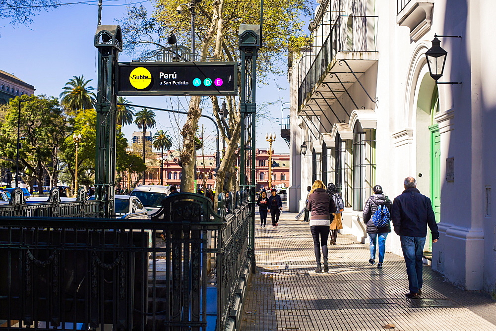 Entrance to the Subte metro and pedestrians walking on street in Buenos Aires, Argentina