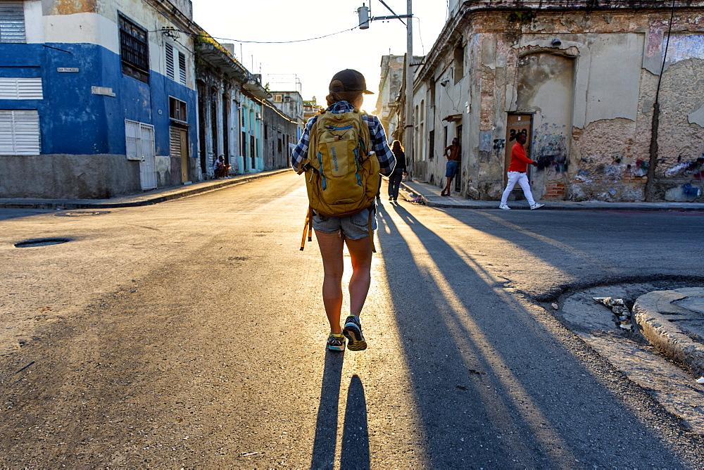 Rear view of female tourist walking in street of Havana, Cuba - 857-95491