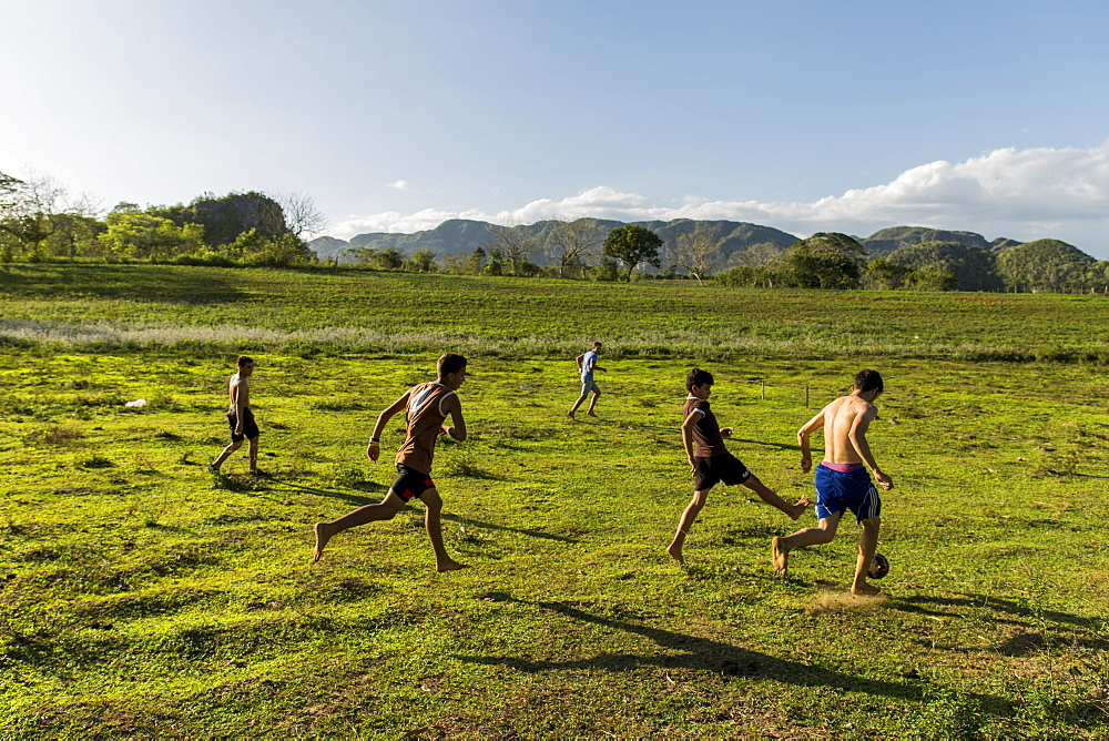 Group of children playing soccer in field, Vinales, Pinar del Rio Province, Cuba