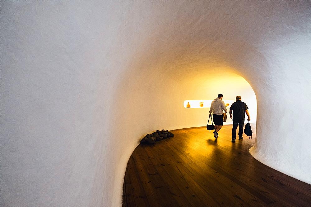 Men walking through corridor in Mirador del Rio by Cesar Manrique, Lanzarote, Spain