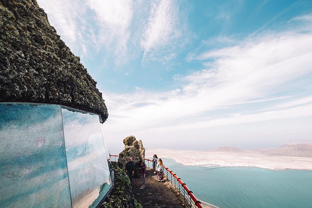 Tourists on viewpoint in front of Isla de La Graciosa, Mirador del Rio, Lanzarote, Spain