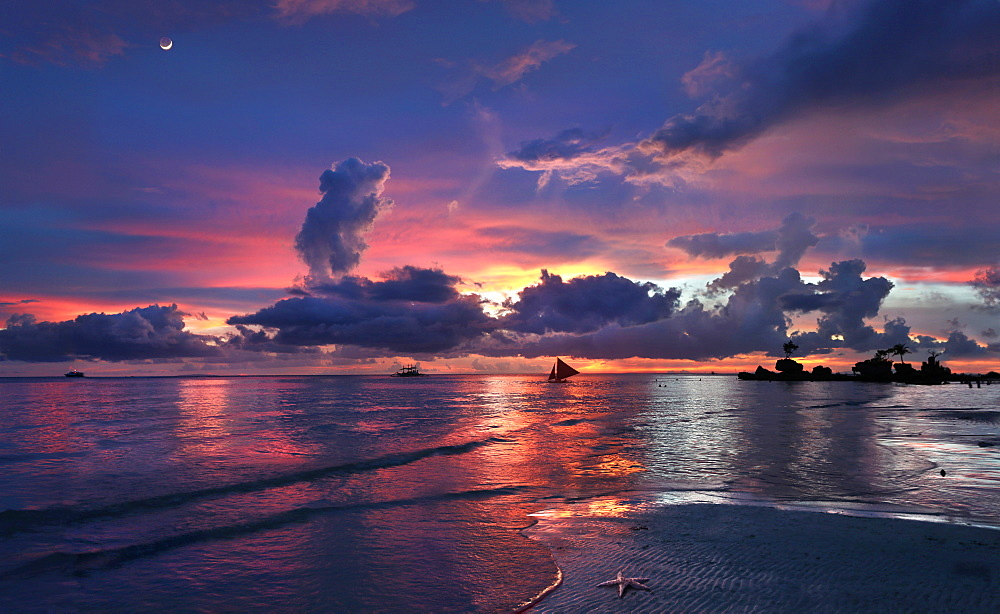 Tranquil scene with beach and sea at sunset with silhouettes of sailboats, Boracay, Aklan, Philippines - 857-95685