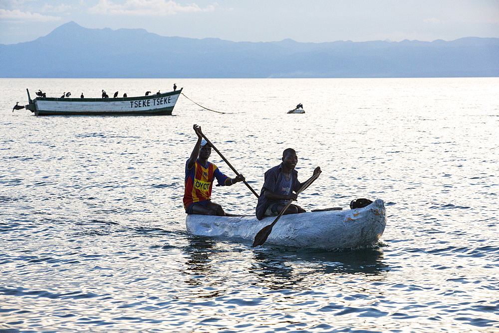 Fisherman in a traditional dug out canoe at Cape Maclear, on Lake Malawi, Malawi, Africa.