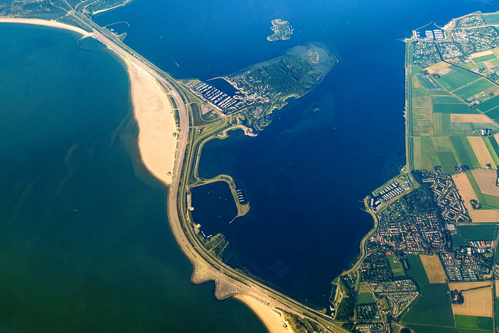 Aerial view of Wadden Sea, city and road across sea, Den Helder, Netherlands