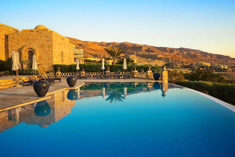 View of infinity pool in resort near Dead Sea under clear sky, Madaba Governorate, Jordan