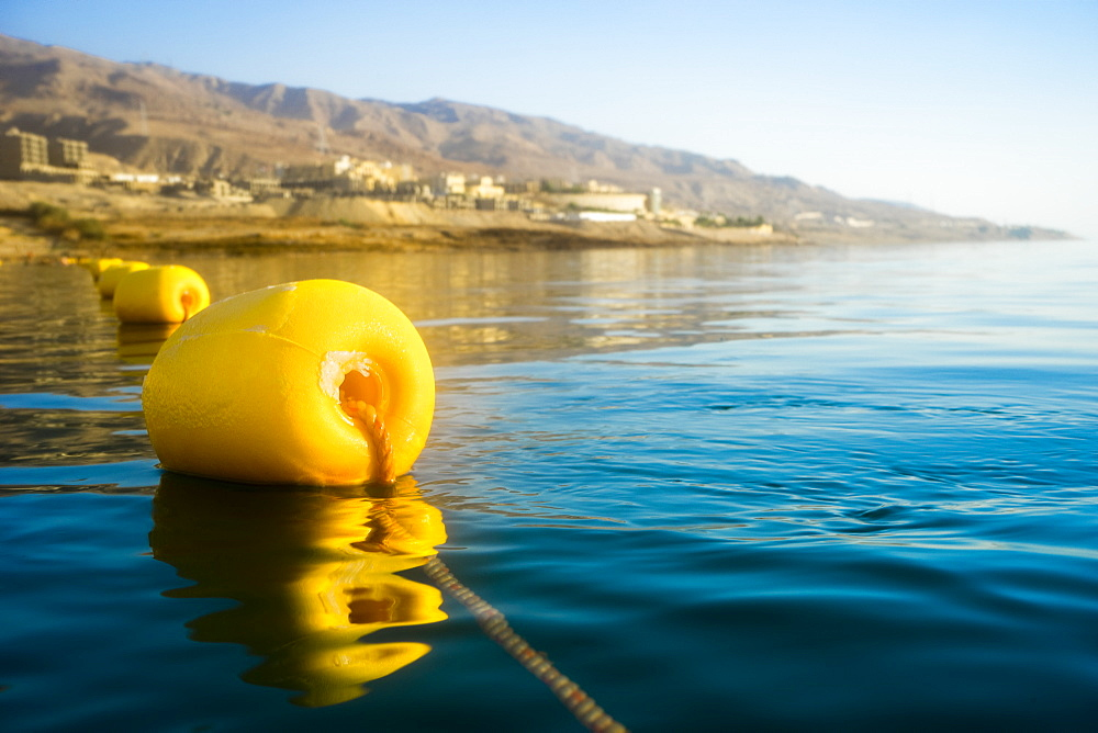 Close-up of single yellow buoy floating on Dead Sea, Madaba Governorate, Jordan
