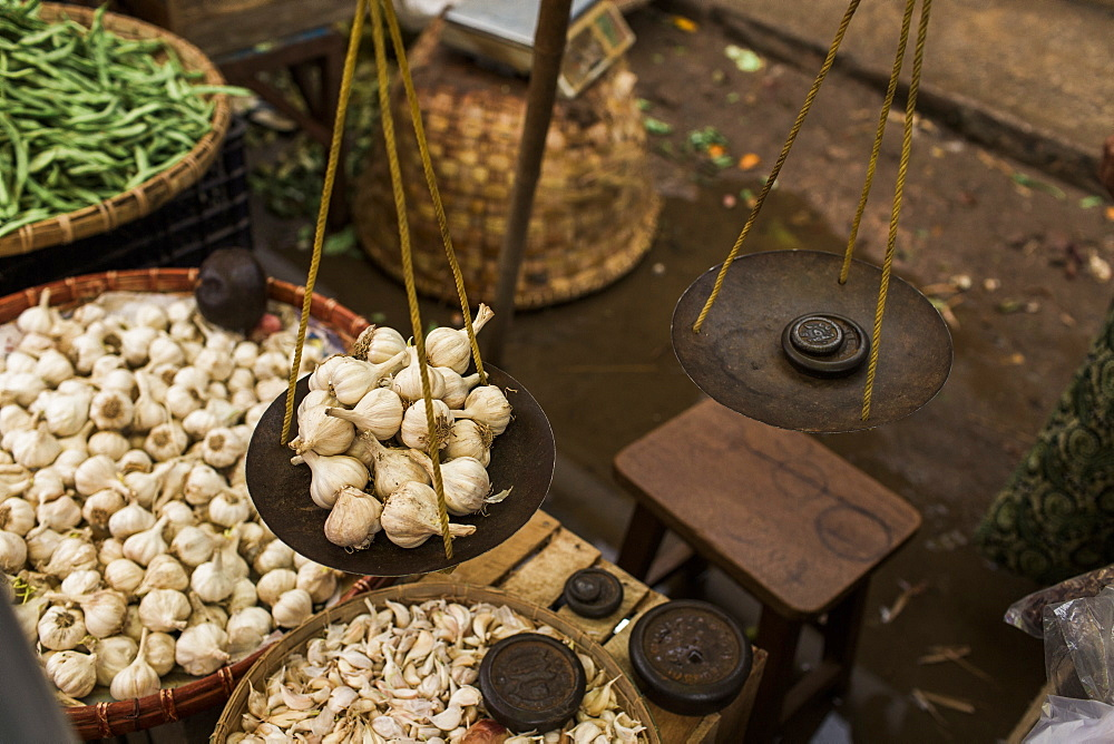 Pile of garlic on outdoor market scale, Myanmar, Shan, Myanmar