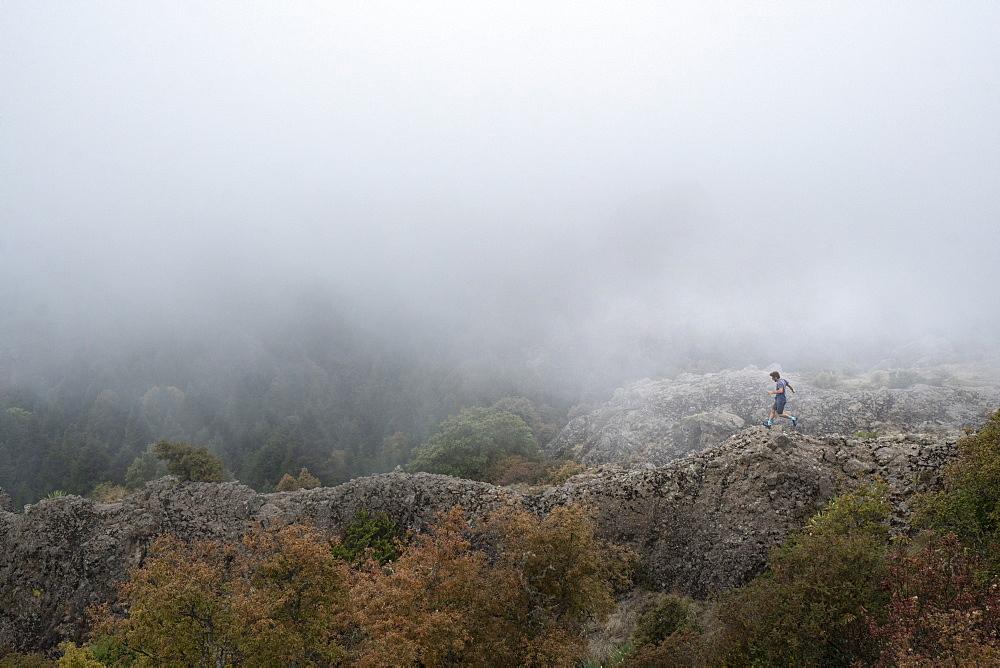 Man running on ridge inEl Chico National Park, Hidalgo, Mexico