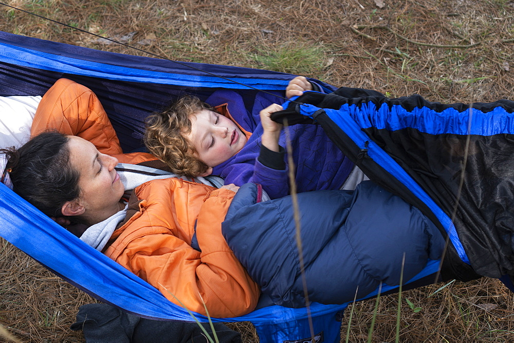 Mom and her son laying in hammock while camping in Rancho Santa Elena, Hidalgo, Mexico - 857-95906