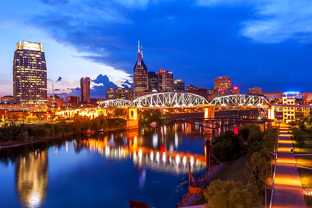 Twilight view of Nashville skyline looking across Cumberland River to central business district, Nashville, Tennessee, USA