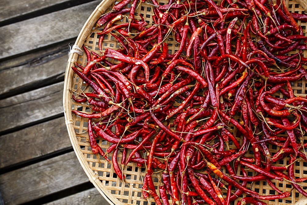 A basket of chilis sits on a dock on Myanmar's Inle Lake, one of the country's most popular tourist destinations - 857-95925