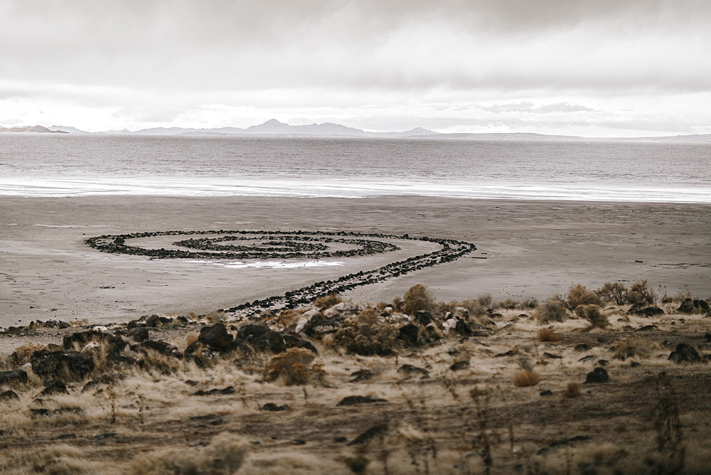 Barren landscape and art named Spiral Jetty designed by Robert Smithson, Spiral Jetty, Utah, USA
