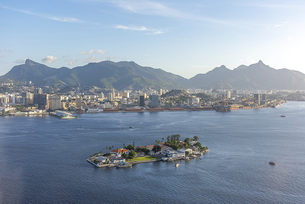 Aerial view of Guanabara Bay island with coastal city and mountains in background, Rio de Janeiro, Rio de Janeiro, Brazil