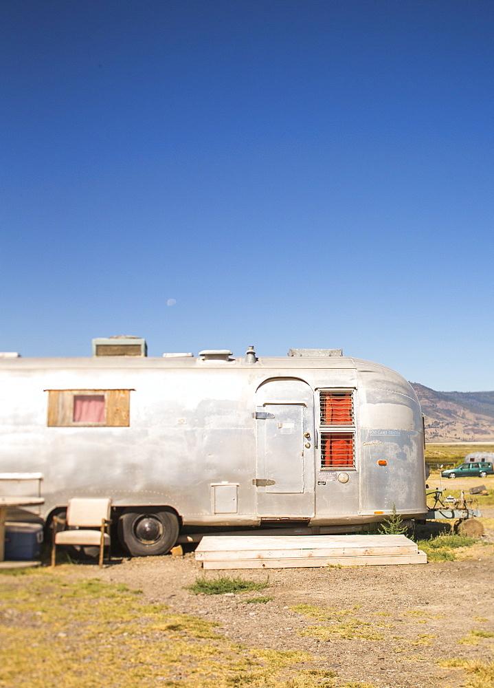 Side view of single camper trailer in desert under clear sky, Summer Lake, Oregon, USA