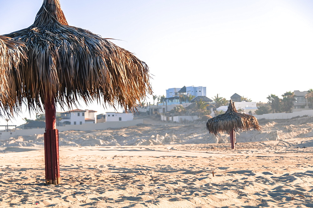 View of two thatched umbrellas on beach, Cabo San Lucas, Baja California Sur, Mexico - 857-96086