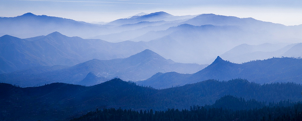 Mountain peaks behind a haze filled valley in the Sequoia National Forest, United States of America