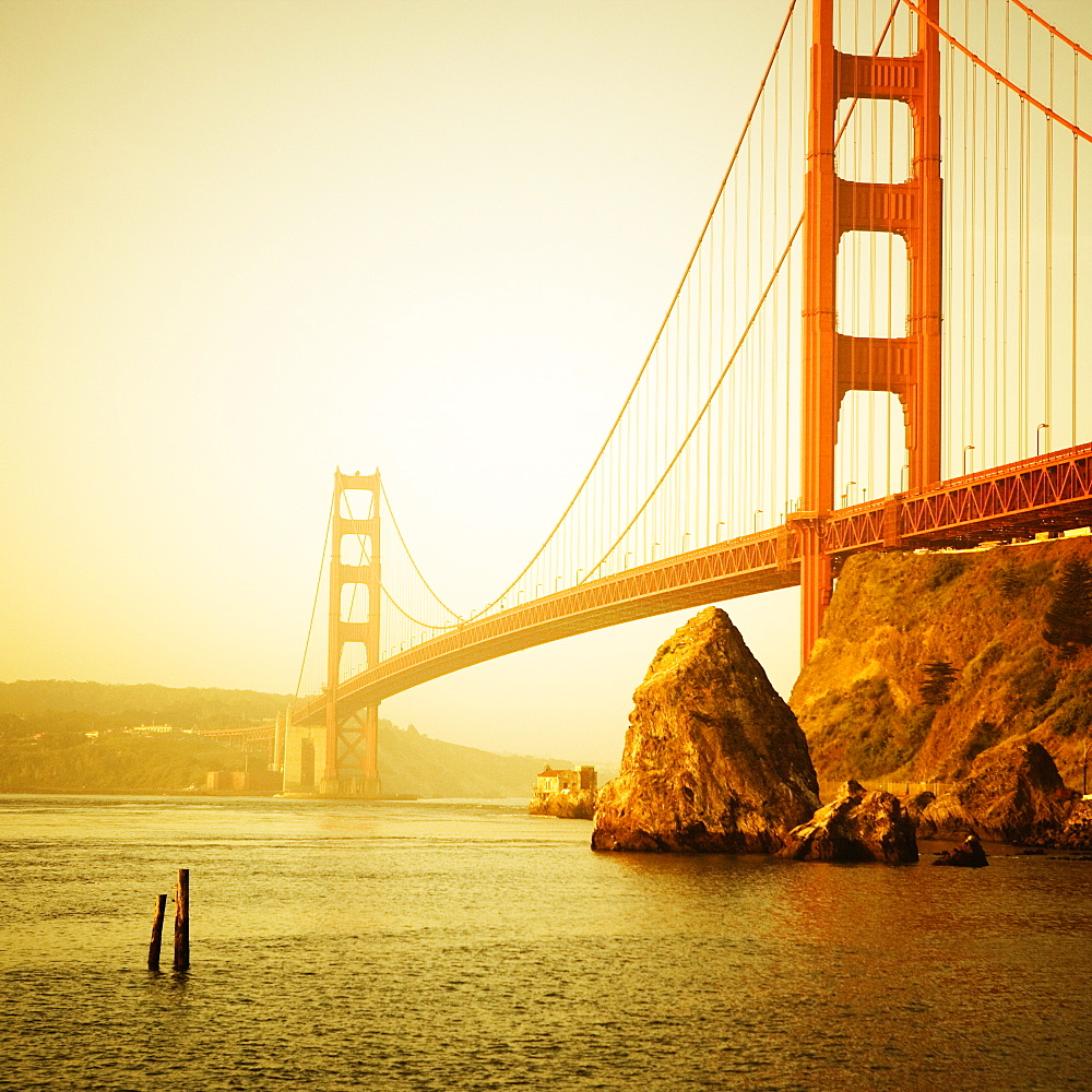 The Golden Gate Bridge from the Golden Gate National Recreation Area, Marin County, California. Tinted yellow.