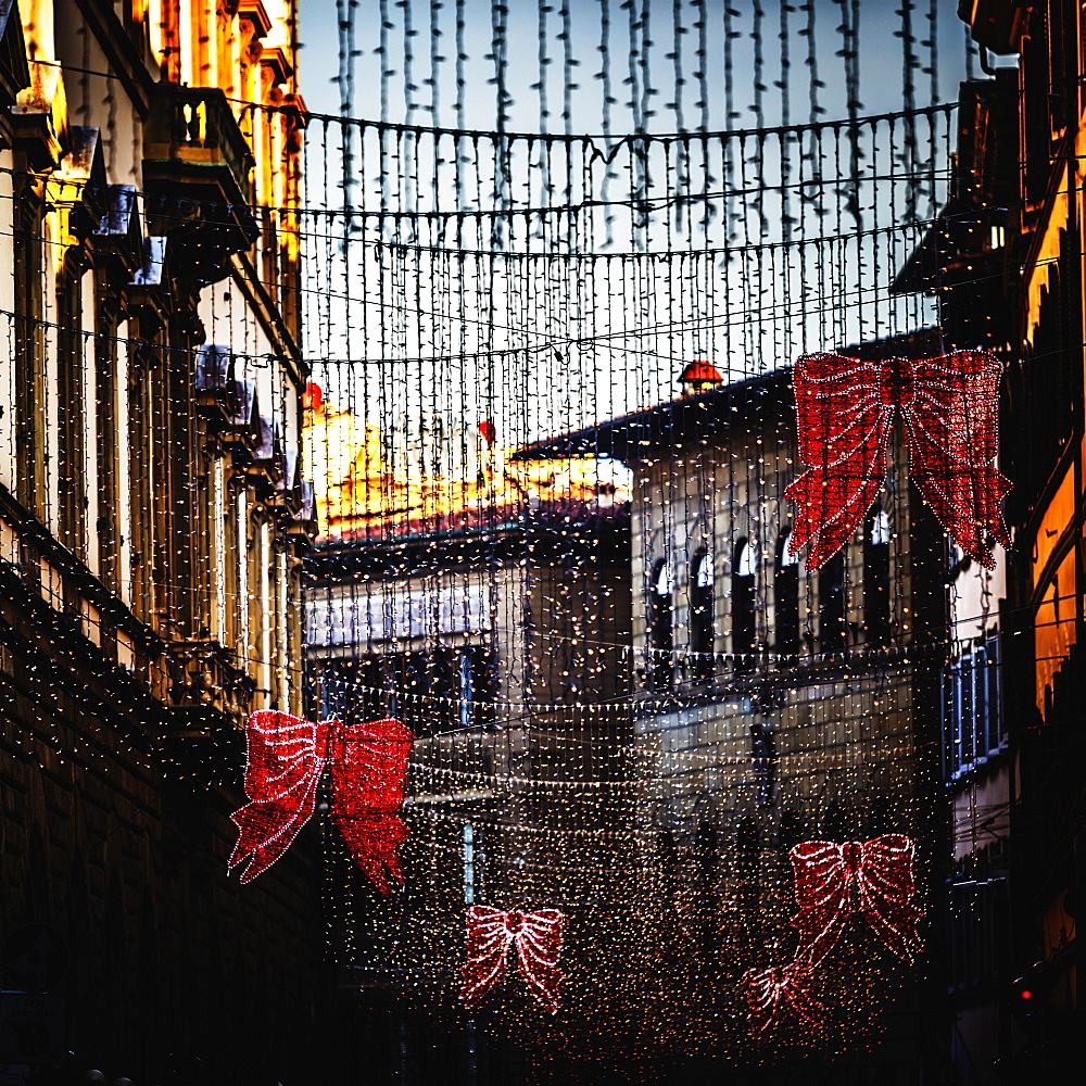 Hanging Christmas decorations and lights over street in Florence, Tuscany, Italy