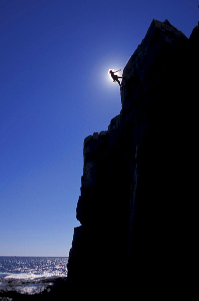 Climber rappelling at Acadia National Park