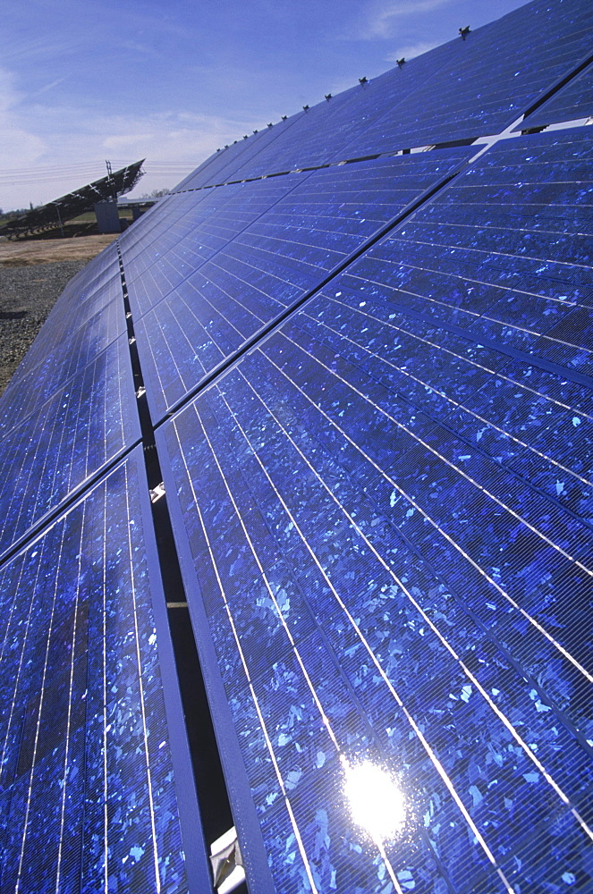 South of Sacramento, California, solar panels that follow the sun with the aid of mechanical timers, stretch across fields at the base of an older, abandoned energy site, a nuclear plant.
