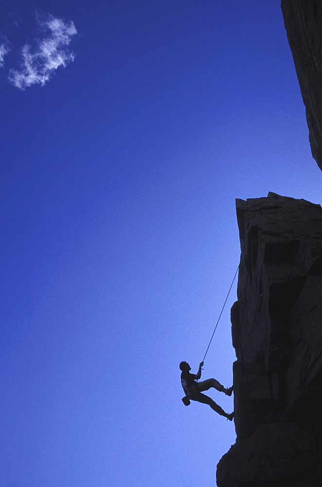 Rappelling off cliff at Acadia National Park, Maine