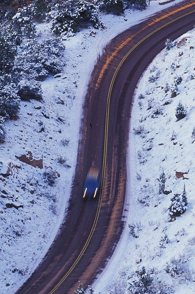 Car on winter road, s curve, Zion National Park, Utah