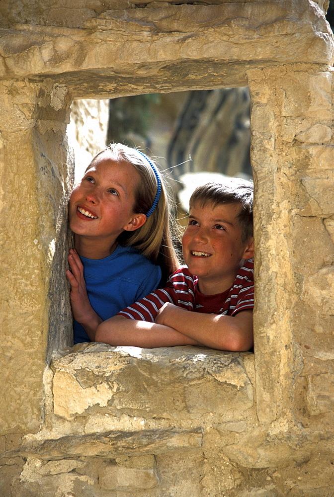 Kids visit Cliff Palace, Mesa Verde National Park, Colorado