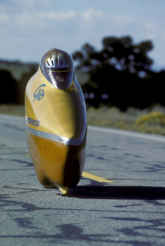 Engineers, athletes and enthusiasts gather on a lonely road in the San Luis Valley in central Colorado to try to break the speed record for a human powered vehicle. These vehicles are basically very, very aerodynamic bicycles.