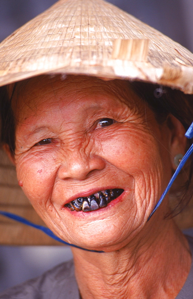 An old lady smiles for a photo in the Purple Forbidden City, Hue.